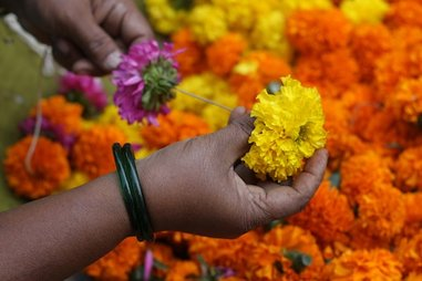 Photo: Threading flowers for offerings, by Meena Kadri